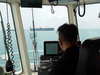 A PSA Marine Tug Master and Wärtsilä's Thomas Brightwell monitoring how the smart navigation system manoeuvres the harbour tug during sea trials