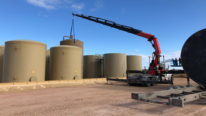 The Knuckle Boom Crane Truck is capable of hauling, lifting and setting large tanks and oilfield equipment