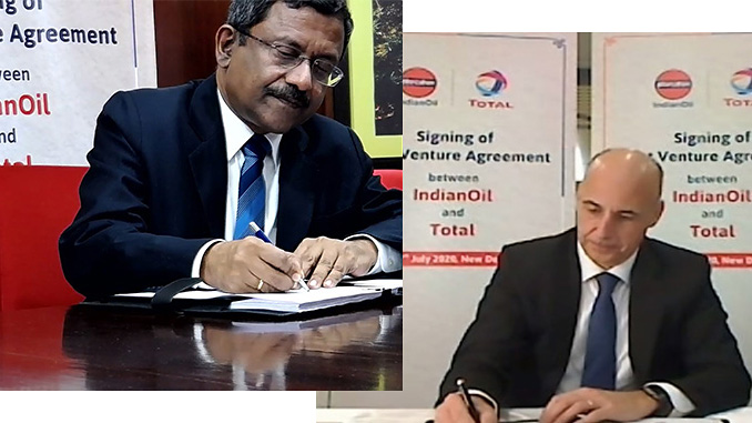 GK Satish, IndianOil Director, Planning & Business Development, and Christian Cabrol, Sr. VP, Asia Pacific & ME Total, signing the JV agreement (photos: IndianOil)