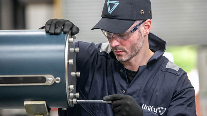 Unity engineer adjusts a QV Actuator