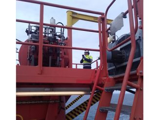 Inspection being performed on one of the two knuckle boom cranes on the Skarv field FPSO