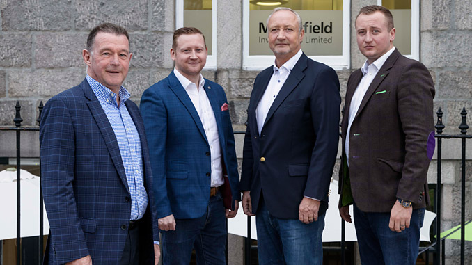 From left, Harry, Mark and Philip Patterson with David Rennie (photo: Mansefield Investments)