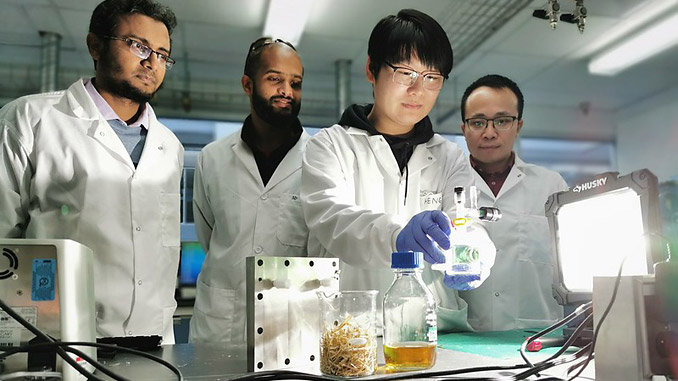 The UCalgary team is observing a photo-reactor that is being used for photoreforming reaction with wheat straw – from left, Prof. Md Golam Kibria, Dr Adnan Khan (Research Associate), Dr Heng Zhao (Post-doctoral fellow), Prof. Jinguang Hu (photo: Prof. Hu and Kibria group)
