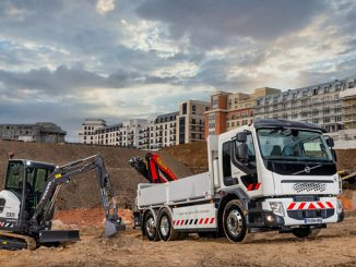 Volvo FE truck, with electrically powered crane, and a Volvo ECR25 Electric compact excavator