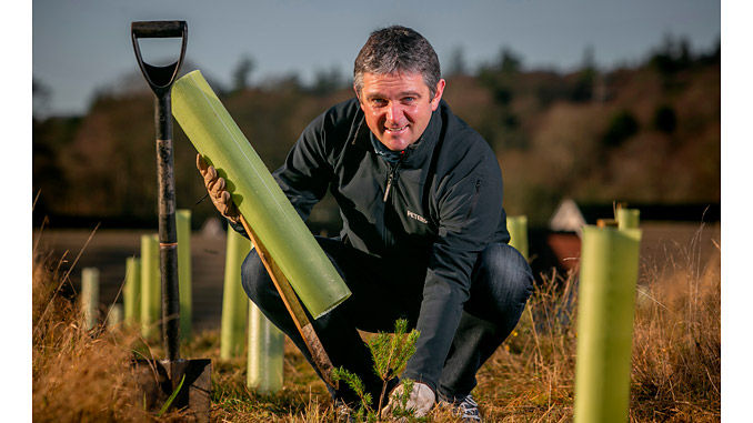 Chris Coull, Regional Director at Peterson, planting trees in Garthdee