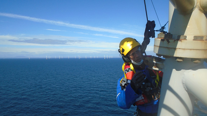 A PD&MS rope access technician working at a wind farm, off the coast of Scotland