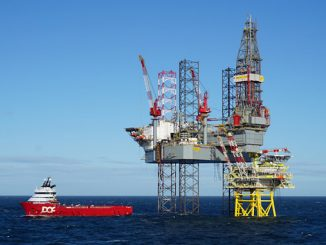 Tolmount with drilling rig and standby boat