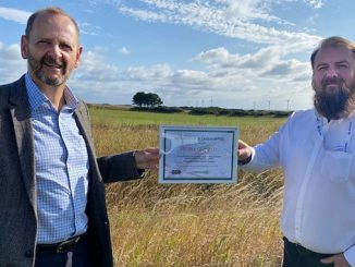 At left, Phil Davie, Nucore COO, presents the Carbon Neutral Certificate to Stuart Insch, Nucore HSEQ Manager and Chair of the CSR team