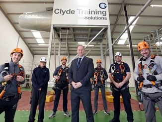 Kris Mcdonald, CTS General Manger (centre) flanked by trainees (orange helmets) and instructors (white helmets)