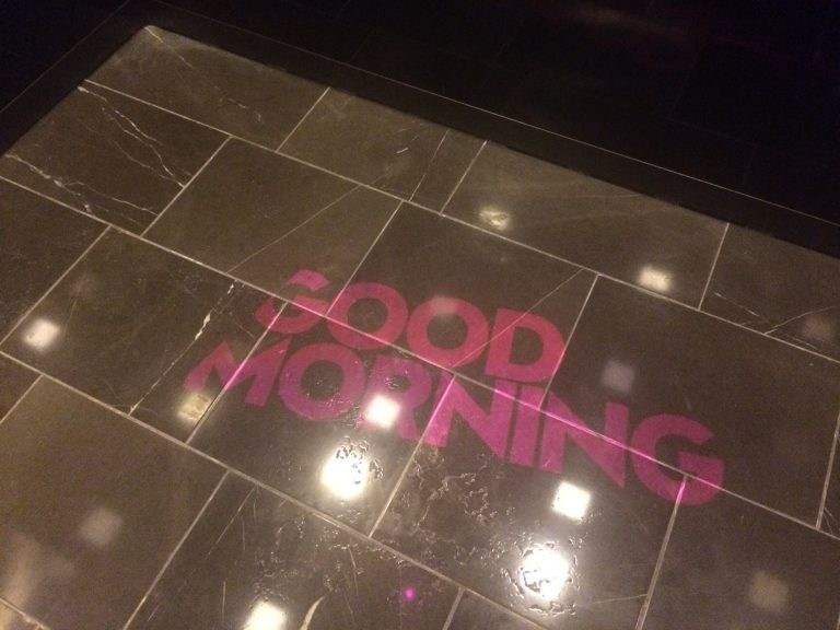 Friendly greeting projected on elevator floor