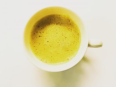 Golden Turmeric Latte on a white background