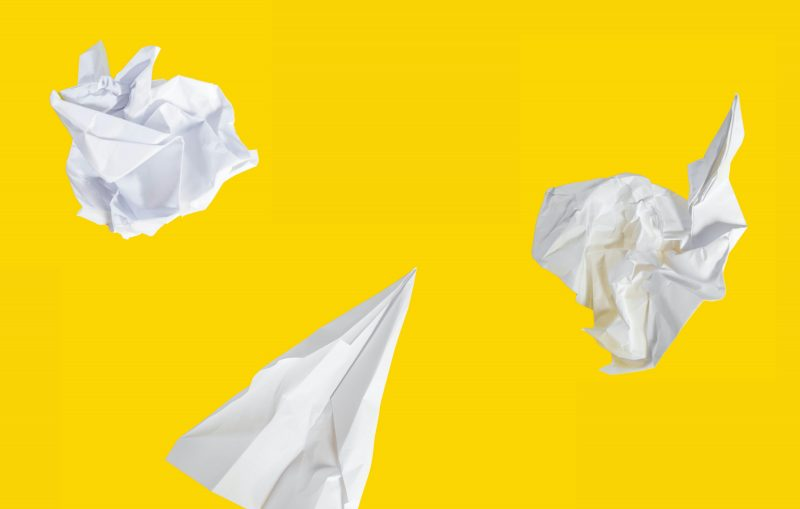 Props of paper on yellow background