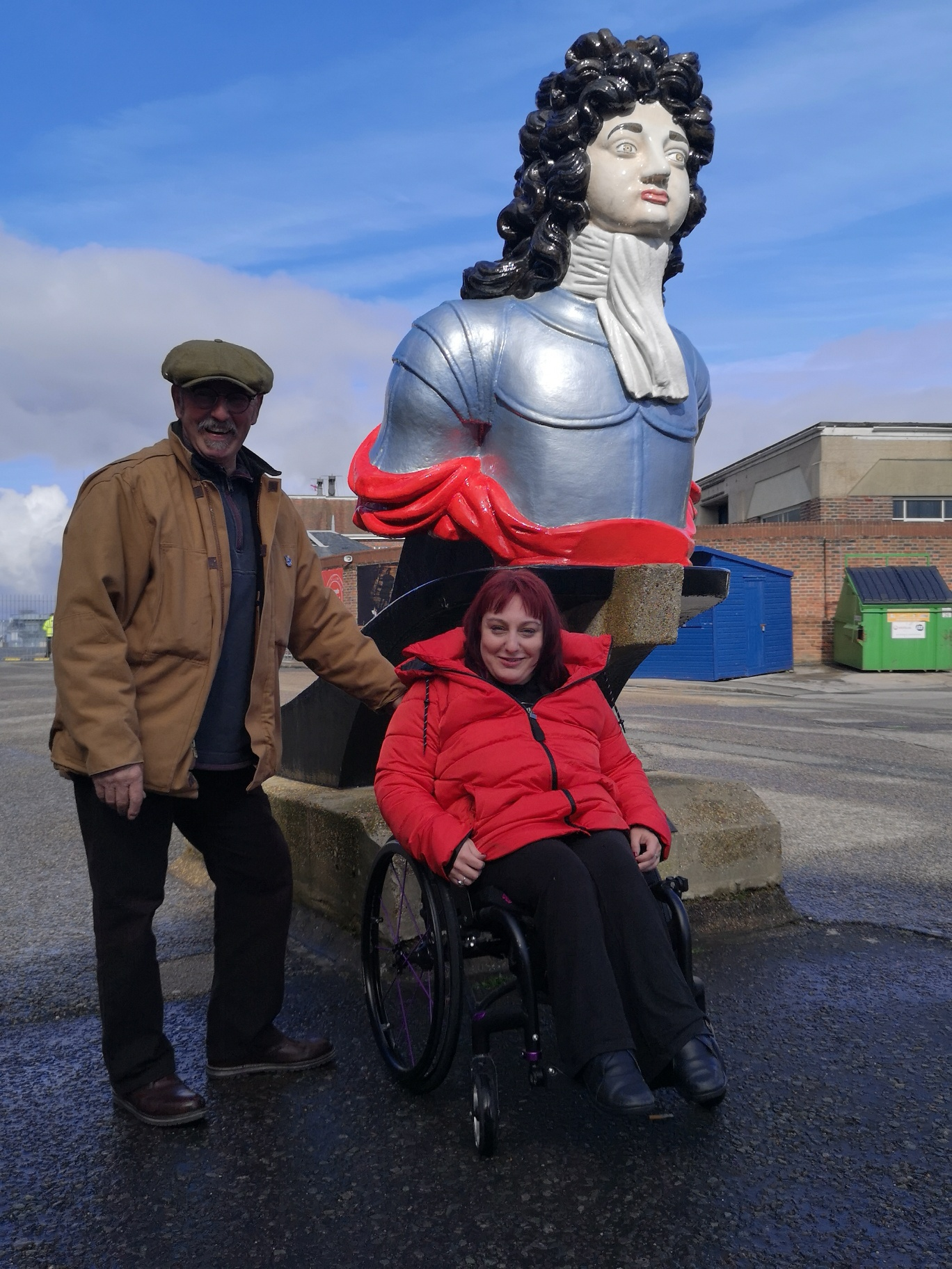 Lucy and her Dad stood in front of a ships figure head for HMS Ben Bow  at Portsmouth Historic Dockyard