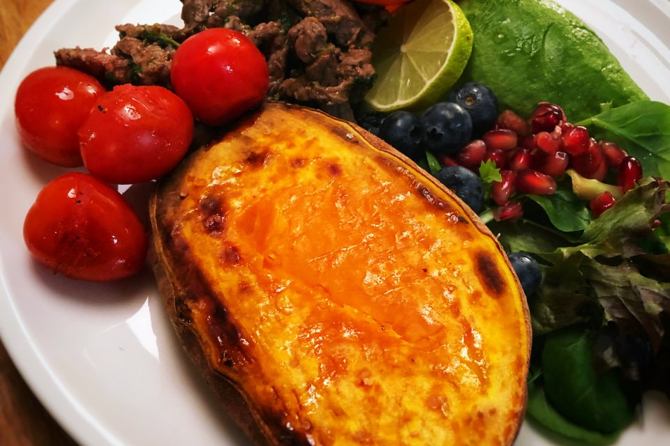 Cilantro fried beef slices with baked sweet potato, blueberries and pomegranate