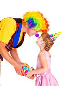 Clown giving present