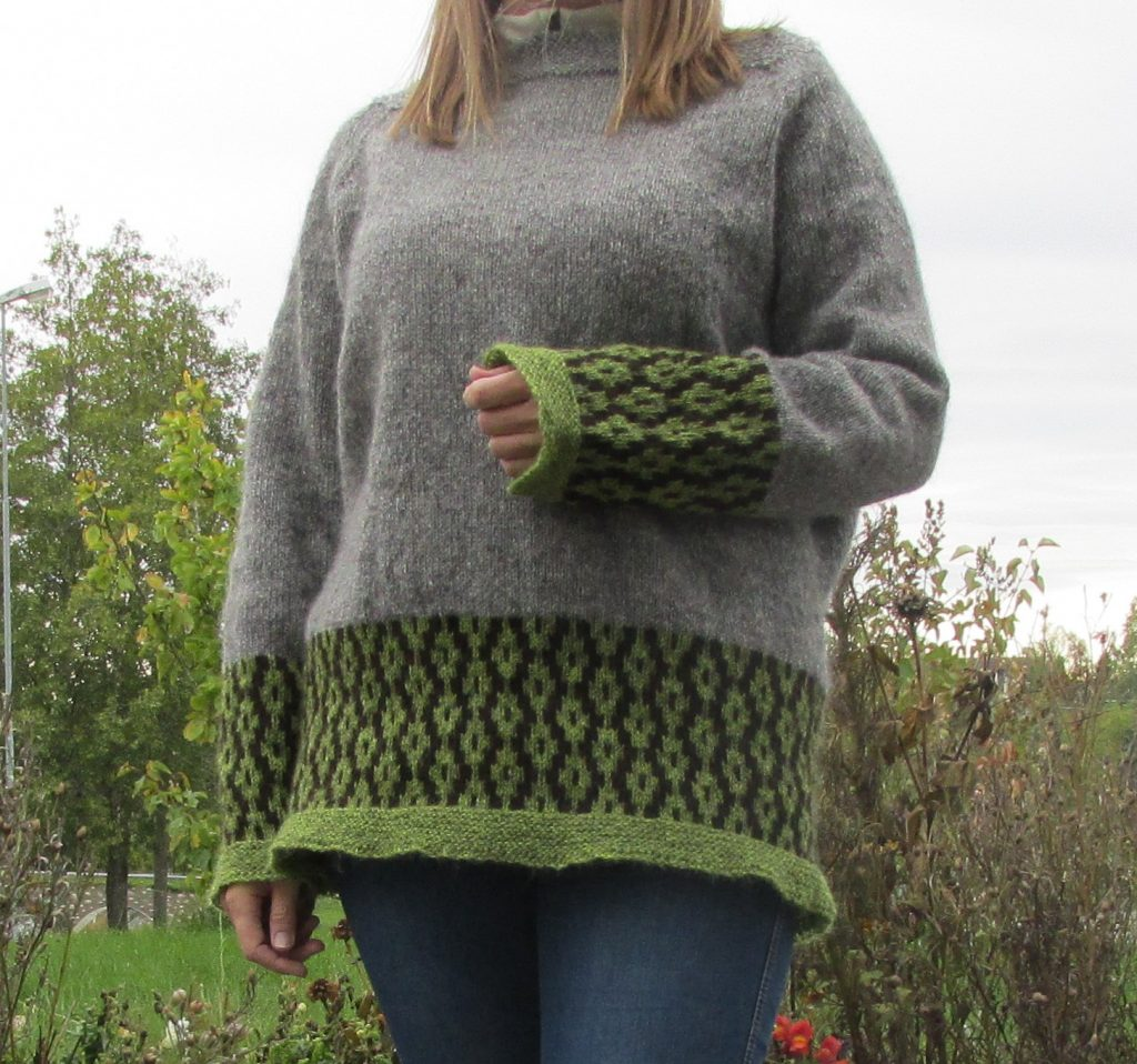 The knitted sweater Spire by Aud B, is inspired of new beginnings.