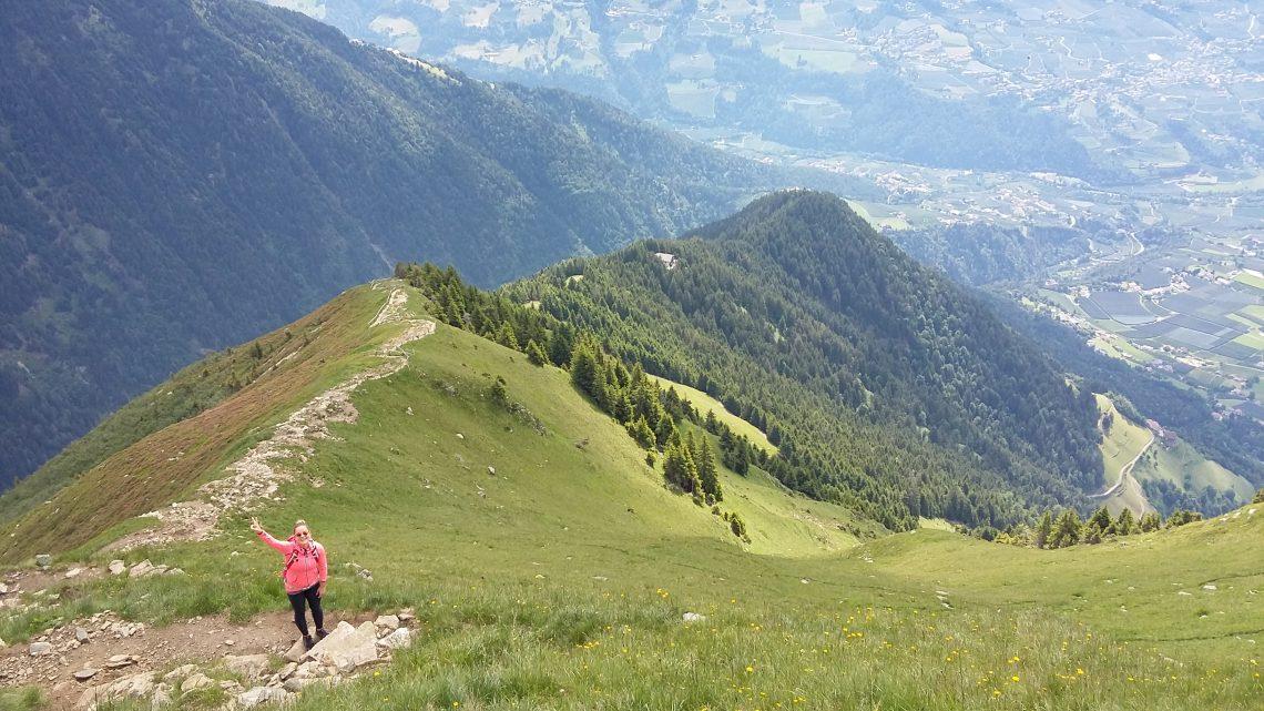 woman hiking up a ridge
