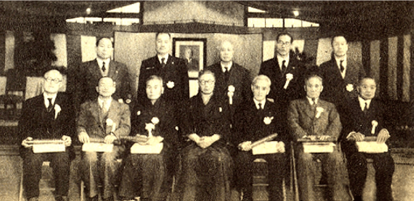 34 Kodokan newly promoted 9 th dan holders on May 1 1948 depicted with the then 10 th