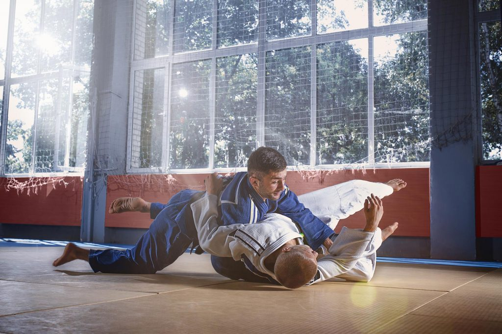 two judo fighters showing technical skill while pr 6K9PUDC