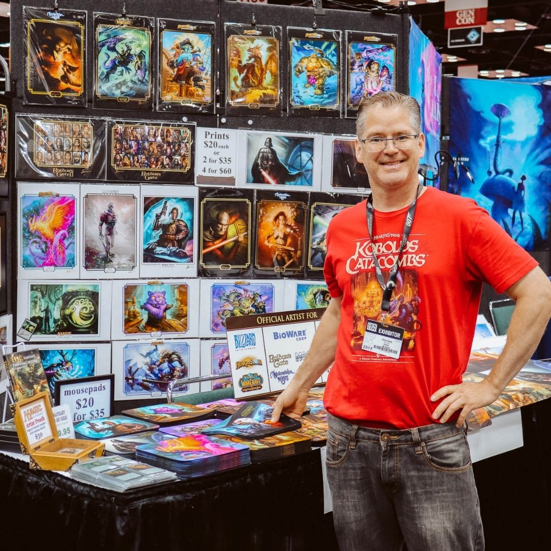Artist Mike Sass at his Gen Con table, 2019