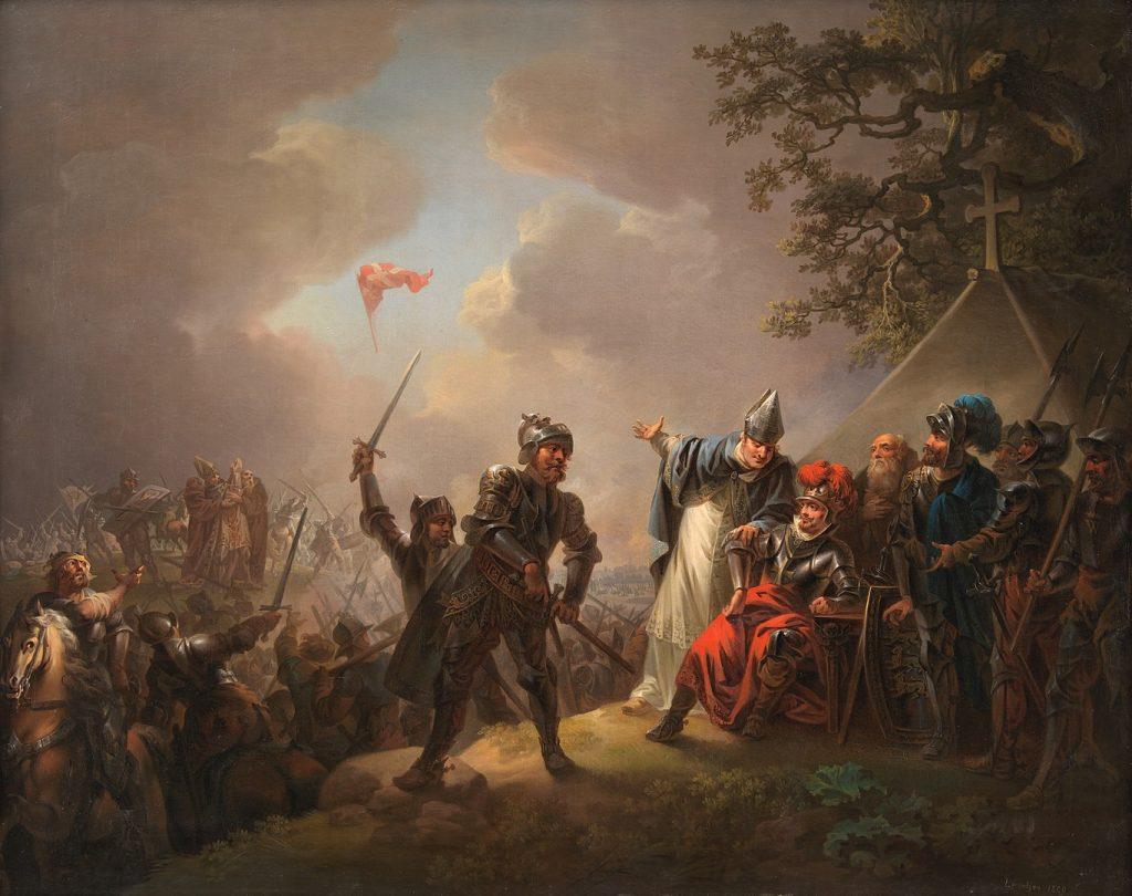Ein Gemälde des dänischen Malers Christian August Lorentzen zeigt die Szene einer Schlacht. Inmitten des Getümmels sind die Wolken aufgebrochen und die dänische Flagge, der Dannebrog kommt auf die Erde nieder, während ein Priester die Hände zum Himmel heben.