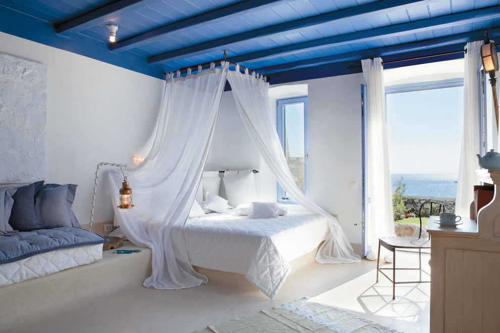 beautiful-airy-white-and-blue-master-bedroom-overlooking-the-Mediterranean