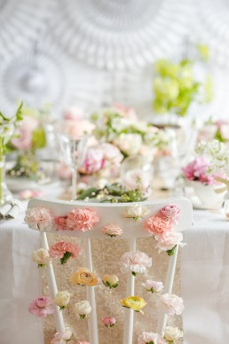 Spring chairback flower waterfall. Photo by Marianne Taylor & flowers by Fairynuffflowers. Click through to see more.