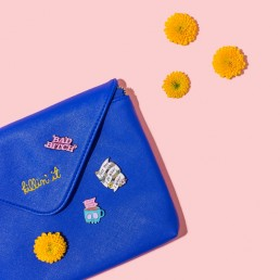 Colourful product & lifestyle photography and styling of enamel pins by Marianne Taylor.