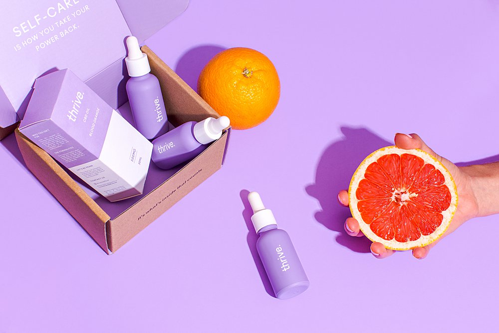 Colourful content creation for Thrive CBD oil. Styled stills and lifestyle product photography by Marianne Taylor.
