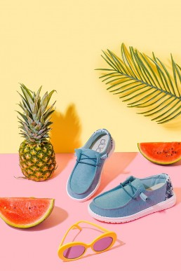 Fun colourful product photography for Hey Dude Shoes. Styled product stills photography by Marianne Taylor.