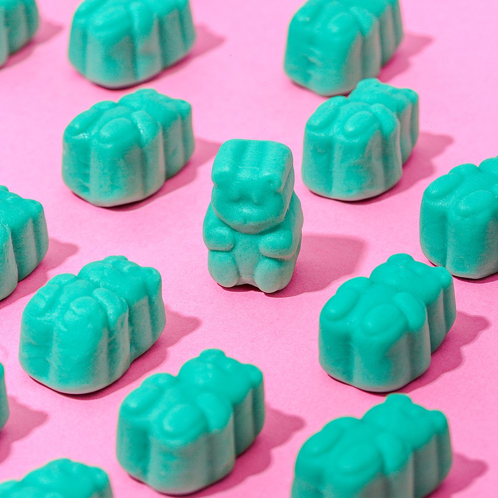 Colourful stills content creation for SugarBearHair hair and sleep vitamins in in pink and blue. Styled health product stills photography by Marianne Taylor.
