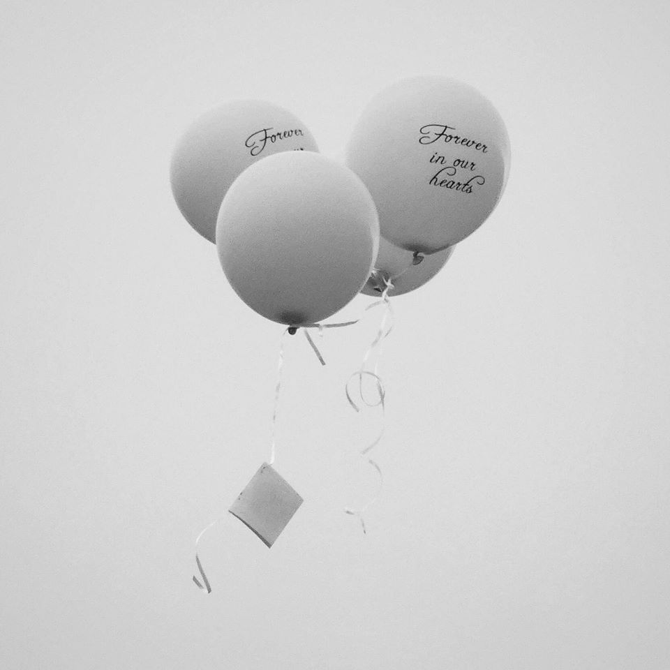 Miscarriage memorial balloons with message attached