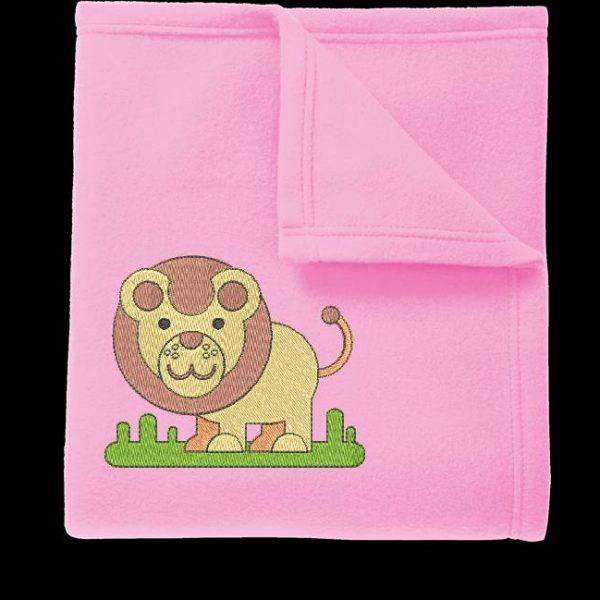 一只小狮子或大草原上行走的幼狮的机绣设计。