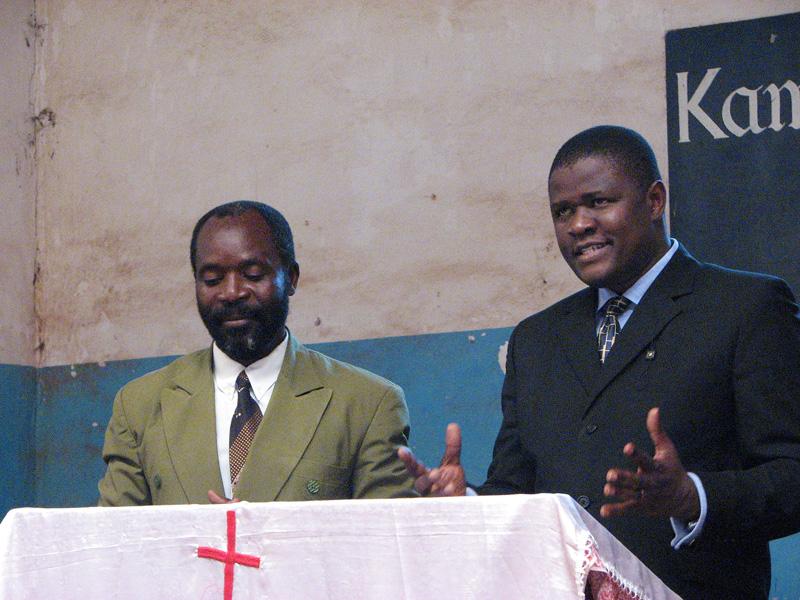 MBA-Interact Handover Ceremony August 2007 Church Service Dr Okoko preaching, Pastor Makule translating
