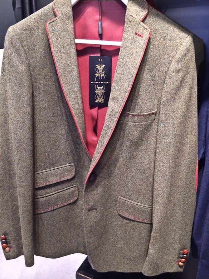 Et bud på en grøn ulden jakke fra Holland Esquire
