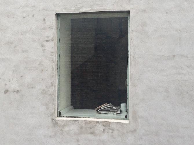 En havde hængt ud i vinduet