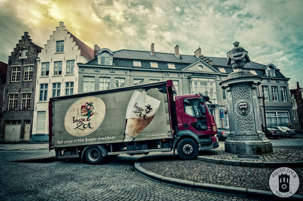 The Brugse Zot delivery van squeezes in somewhere in Bruges Belgium. Photo by Photo Tour Brugge.
