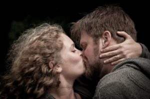 """Matt & Rachel sneak a smooch during an """"Save the Day"""" photoshoot in Bruges Belgium. Photo by Photo Tour Brugge."""