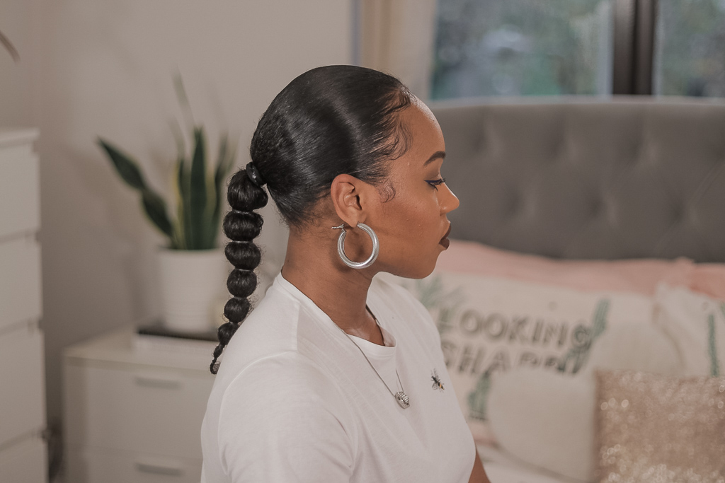 sleek low bubble bun on natural hair