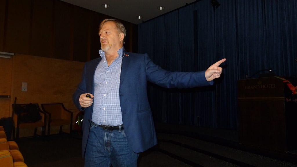 dalloca talks on stage