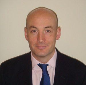 Dr Miles Behan