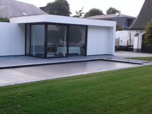 Gerenoveerde villatuin Renovatie verhardingen en aanleg zwembad in villatuin BB – Melle