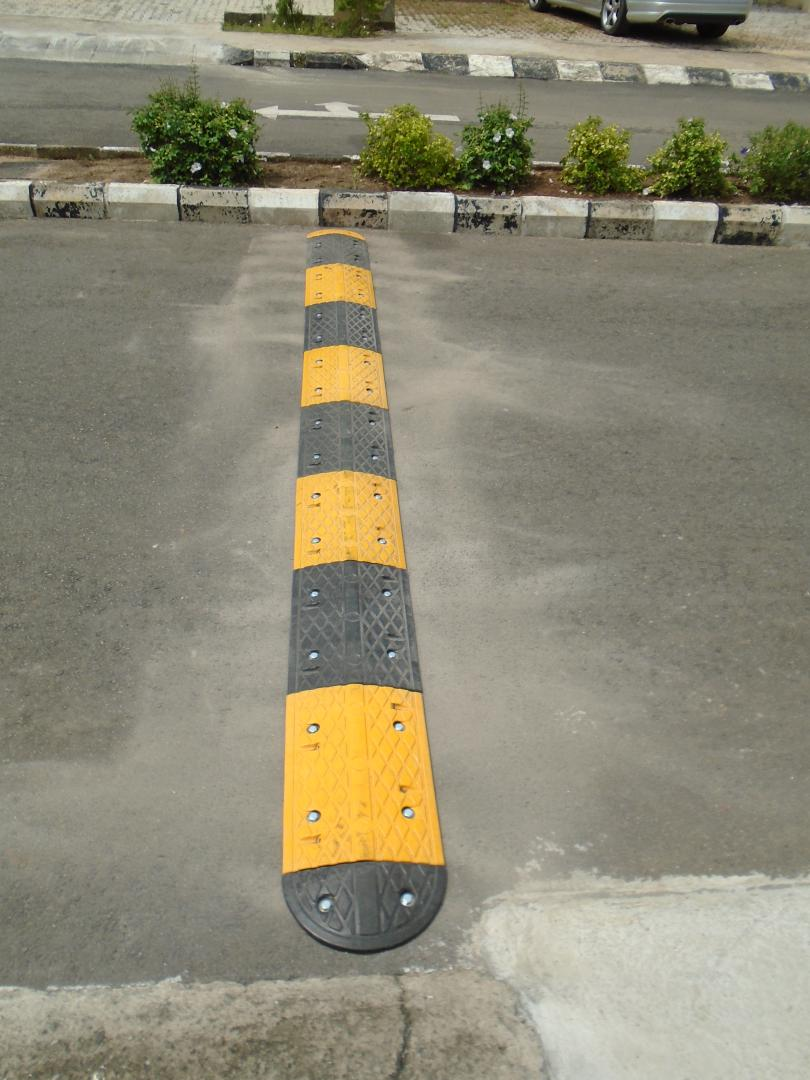Installation of 36 meters 50mm Rubber Speed Bump at Flowergate Estate, Abuja Nigeria.