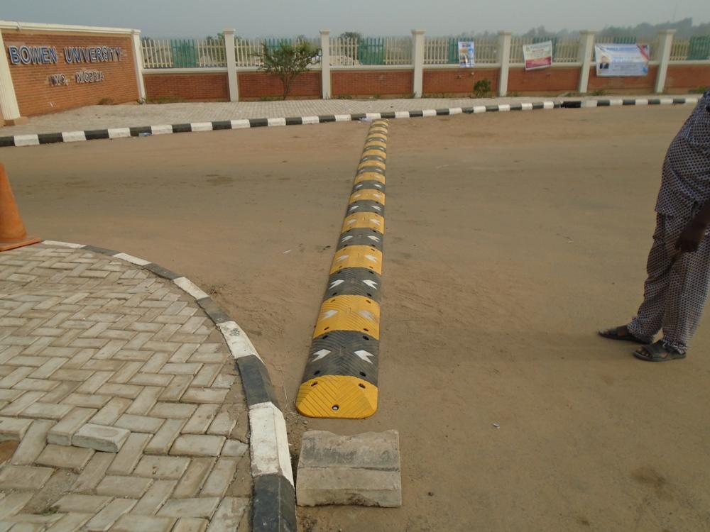 Installation of 24 meters 75mm Rubber Speed Bump at Bowen University Main Entrance Gate, Iwo, Osun State, Nigeria