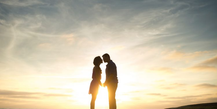 Couple kissing in the sun