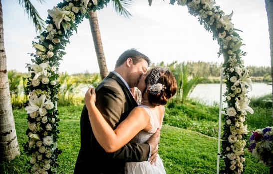 Tropical Riverside Wedding with White Flower Arch | Hoi An, Vietnam