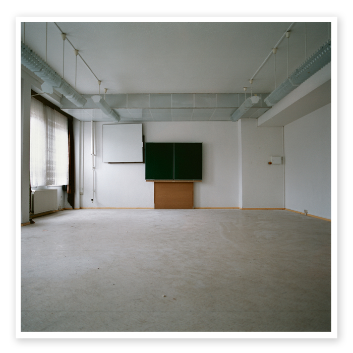 Final Report 05 | View into an emptied classroom with a blackboard mounted to the wall