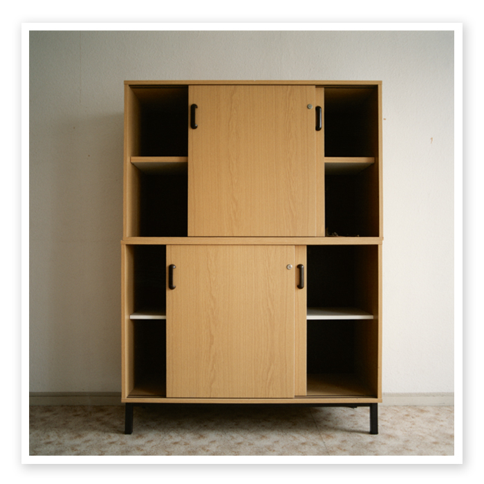 Final Report 13 | Frontal view of a classical DDR filing cabinet made from veneered chipboard