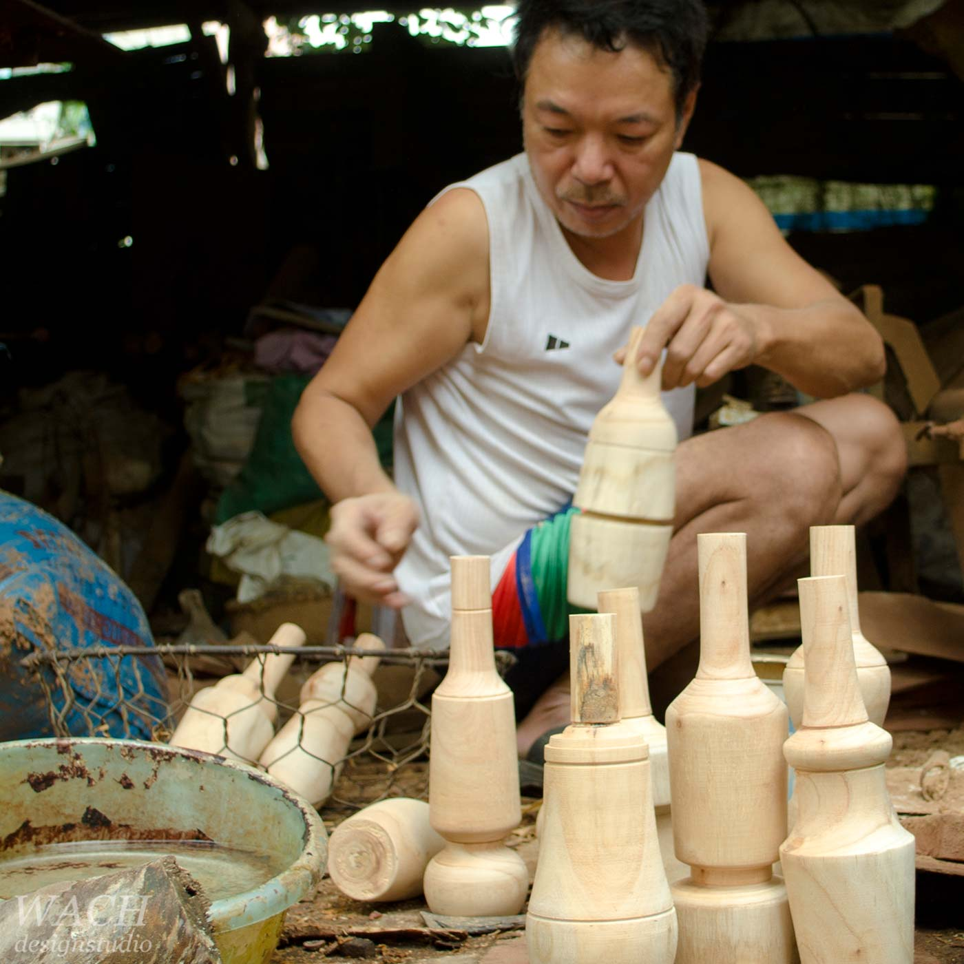 Vietnamese carpenter preparing Flaska wood solids, designed by WACH designstudio, for the manufactory of moulds for glass blowing