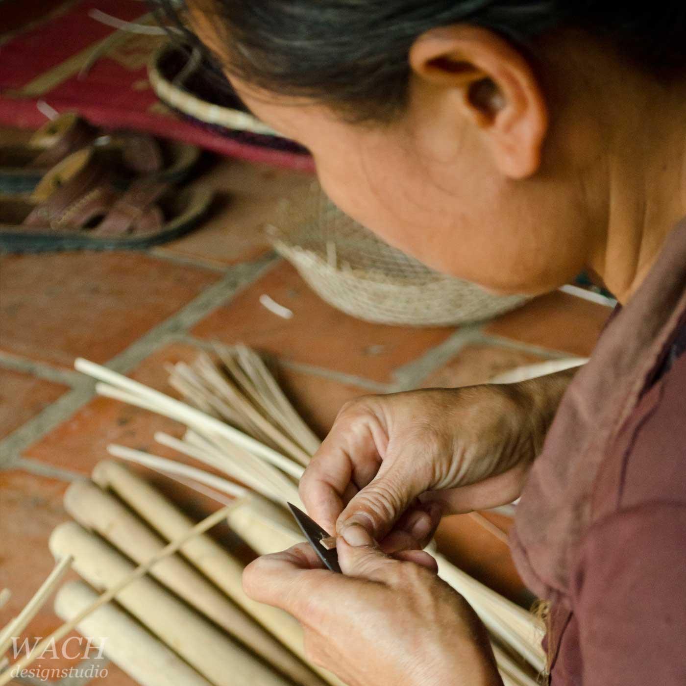Vietnamese women crafting bamboo stripes for basket weaving